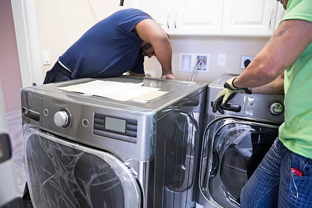 electrician installing washer